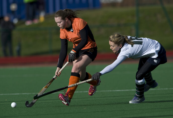 Leicester's Emily Kilner is chased by Surbiton's Sarah Page (c) Ady Kerry