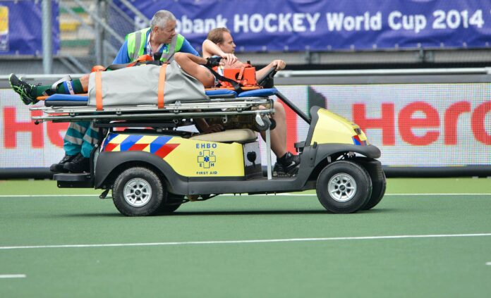 Mark Knowles is taken from the pitch at the Kyocera Stadium (c) hockeyimages.co.uk