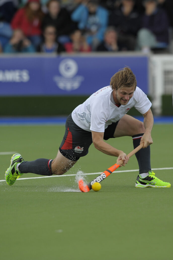 Ashley Jackson drag-flick for England against Canada during their final Pool B game at the XX Commonwealth Games, Glasgow, 31st .jpg