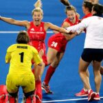 Maddie Hinch celebrates with Team GB team-mates